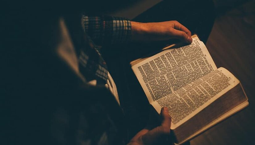 people-man-sitting-alone-reading-holy-book-bible-dark